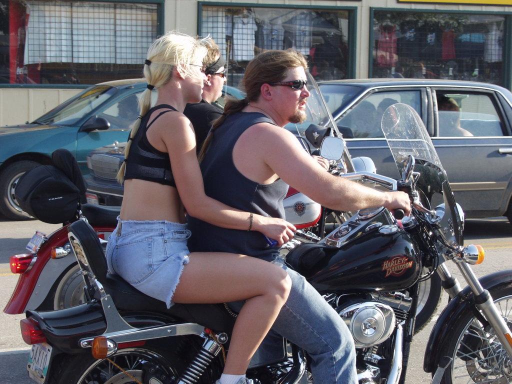 Blonde woman and biker