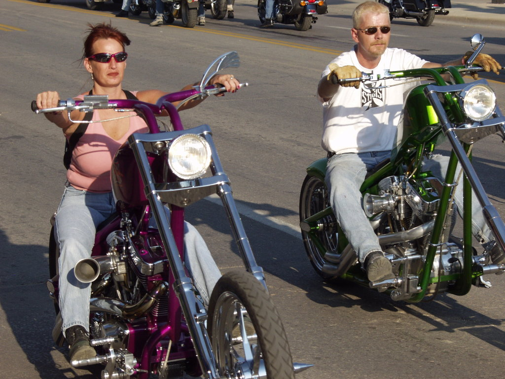 woman rides chopper