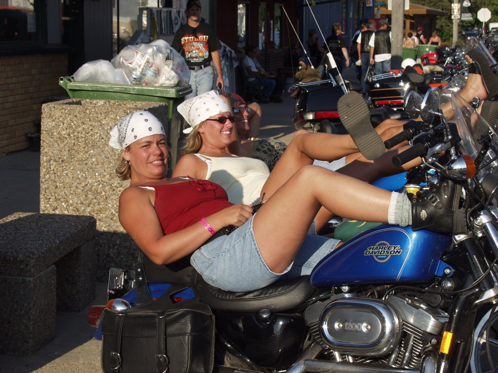 women laying on motorcycle