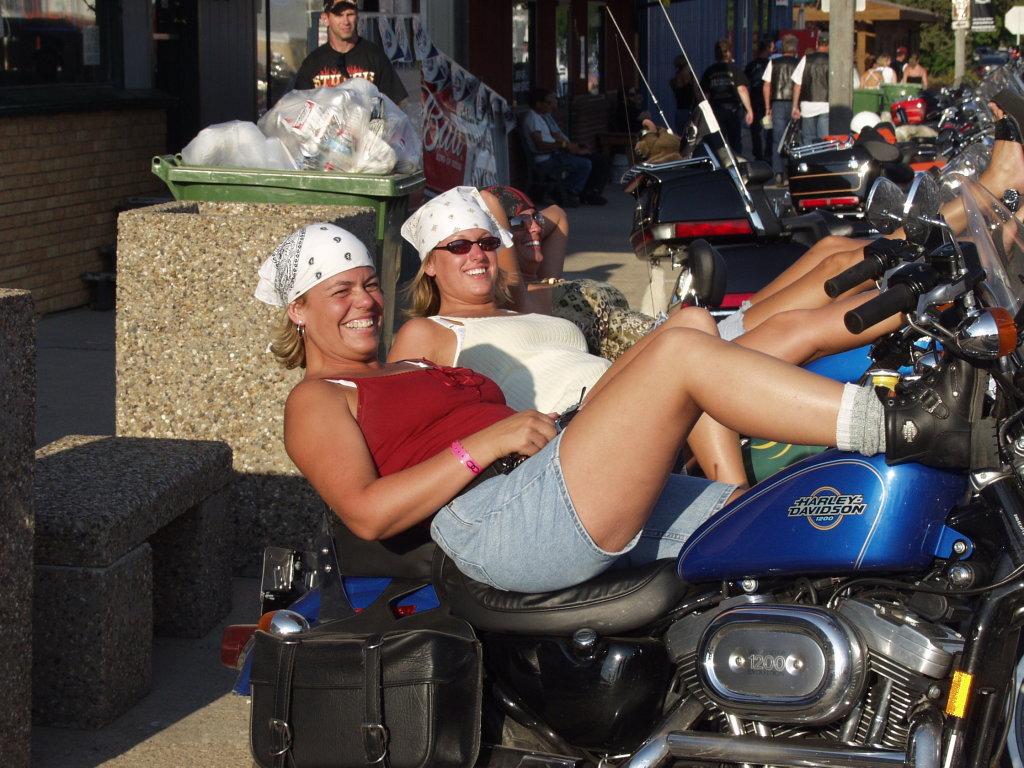 two women lie on bikes