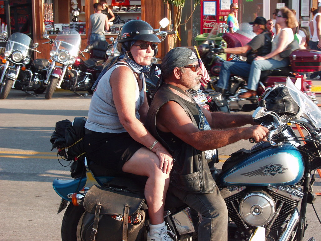 two motorcyle people