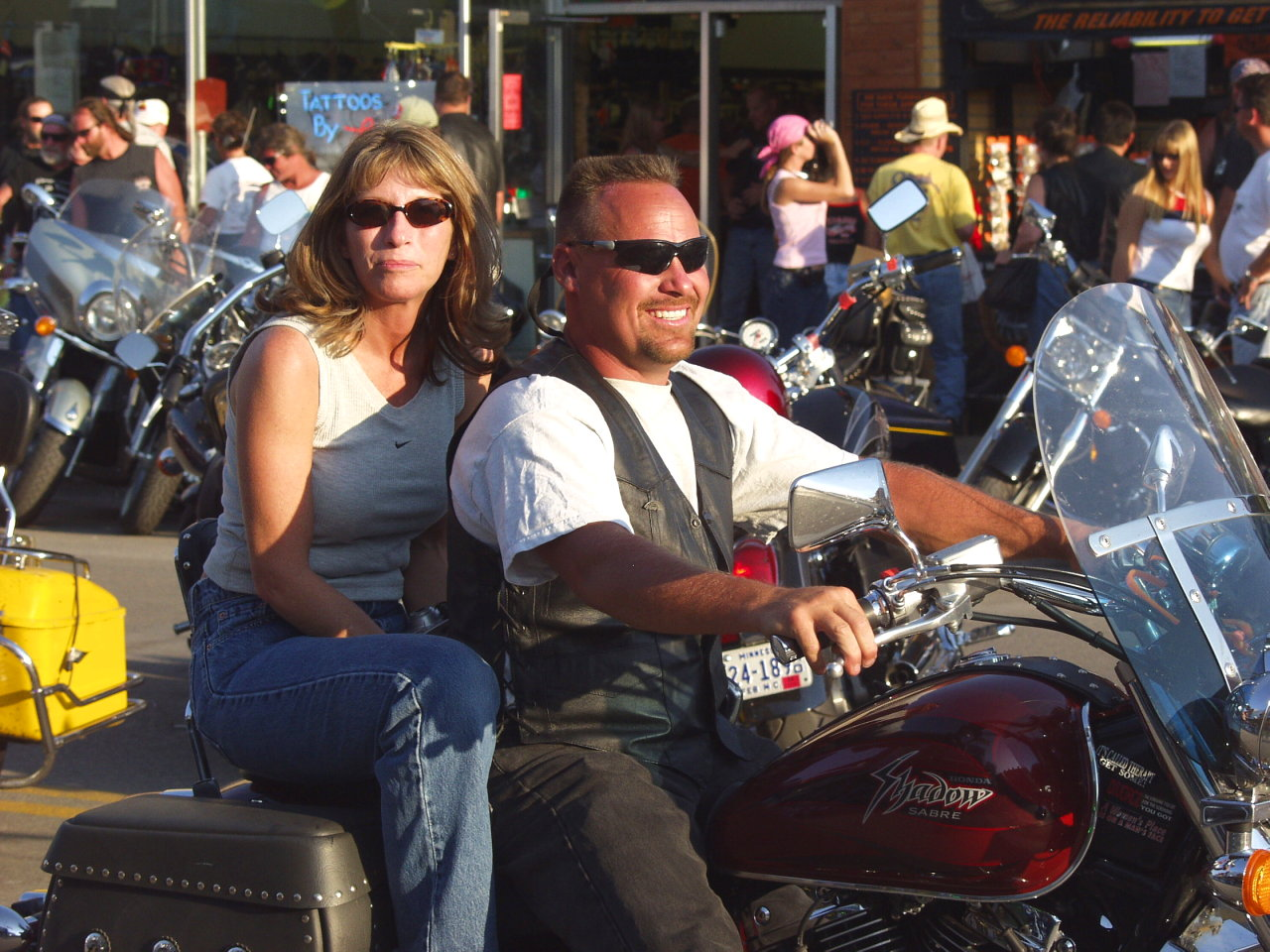 Smiling motorcycle people