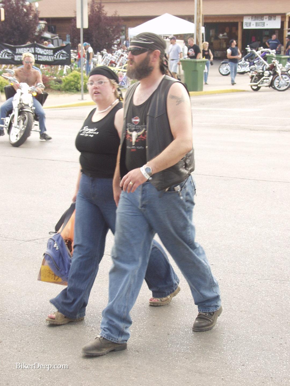 Motorcyclists walk